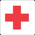Ensiapuasema. Kuvassa on punainen risti. Valkoinen tausta.