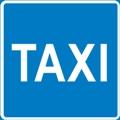 """Taksi. Kuvassa on teksti """"Taxi"""". Sininen tausta."""