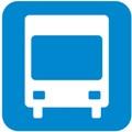Bussi. Kuvassa on bussi kuvattuna edestäpäin. Bussin runko on valkoinen ja siitä erottuu iso etuikkuna ja etuvalot. Alla on kaksi pyörää. Sininen tausta.