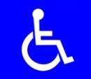 Esteetön wc merkitään ISA -tunnuksella. Kuvassa on pyörätuolissa istuva henkilö. Sininen tausta.