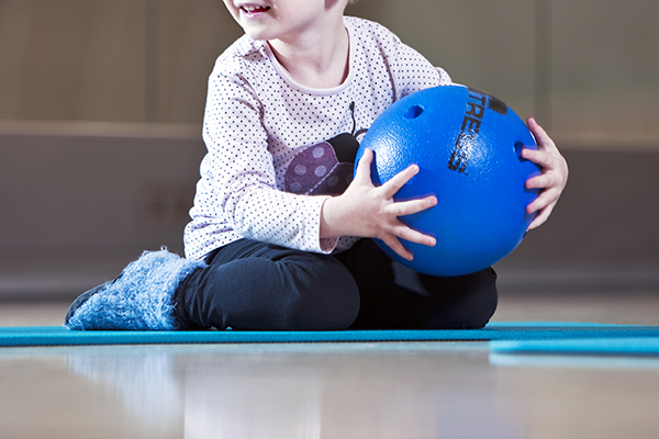 A child with a ball inside.