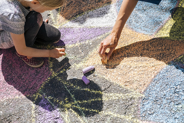 Children drawing on asphalt