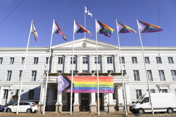 Pride flags in front of the Helsinki City Hall. Photo: Kimmo Brandt