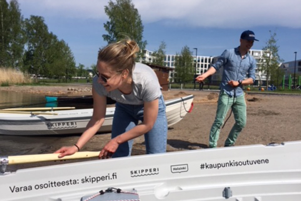 Helsinki maritime strategy project manager Minttu Perttula giving a hand with the city rowboats as they were landing at Töölönlahti.