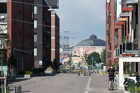 The Suvilahti gasometer is a landmark building also for nearby Kalasatama. Photo: Juho Nurmi